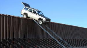 Smuggler's vehicle gets stuck on border fence