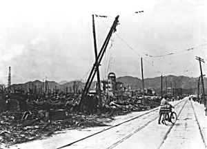 The ruins of Hiroshima. Note the tower with the rounded top (from the above picture) in the background. (click image to enlarge)